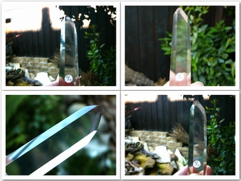 Polished crystal clear phantom quartz point