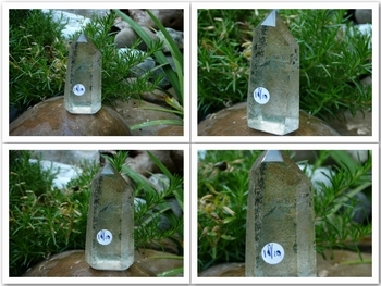 Partly polished crystal clear phantom quartz point