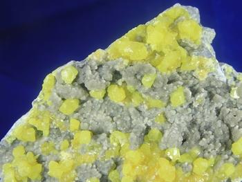 Sulphur crystal on aragonite