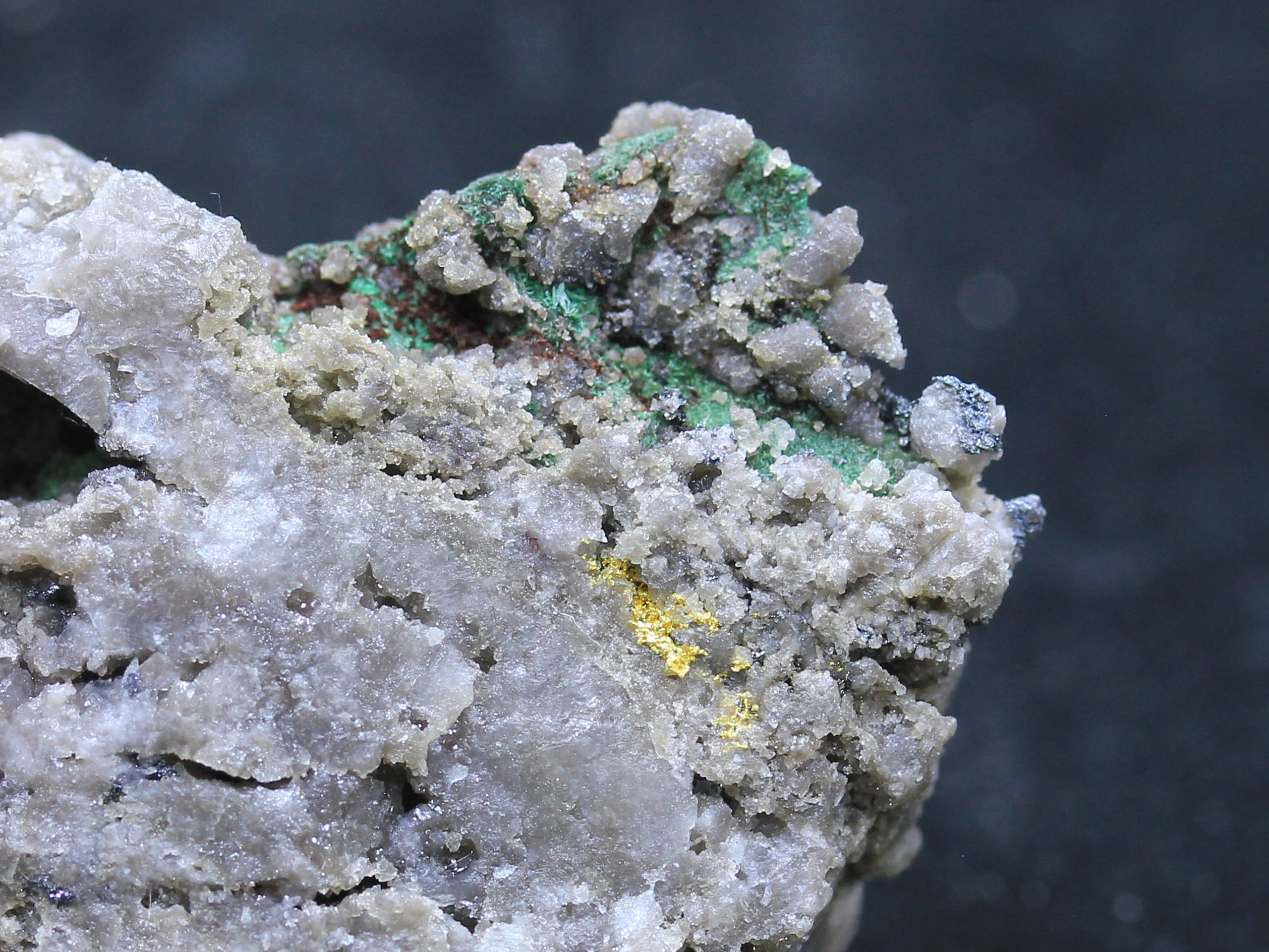 Gold on quartz, bornite and malachite