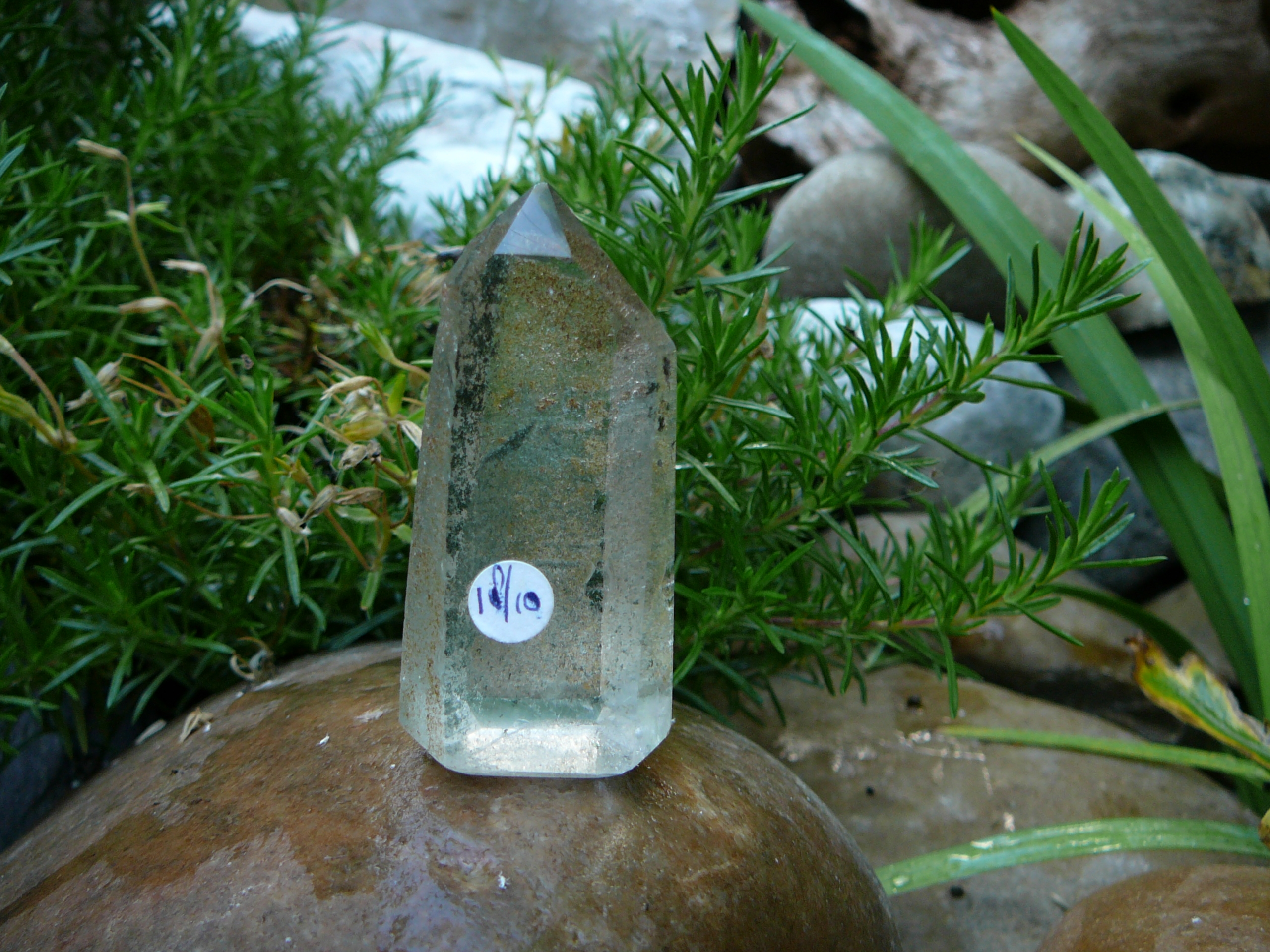 Partly polished crystal clear phantom quartz point