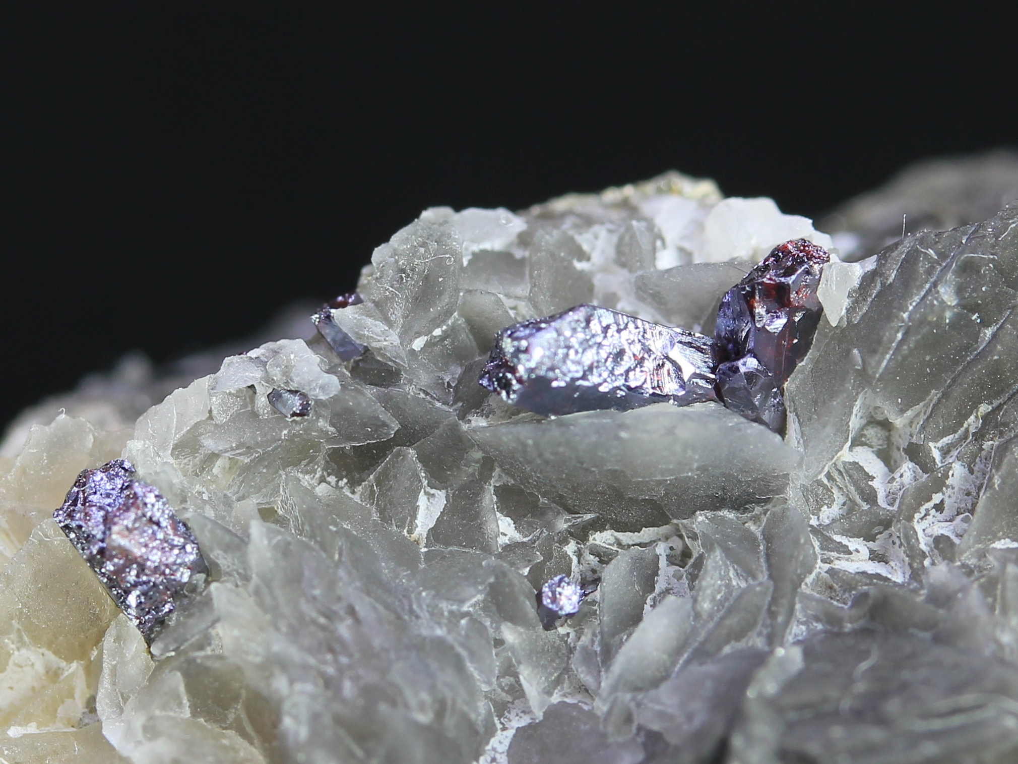 Proustite crystals on a calcite layer