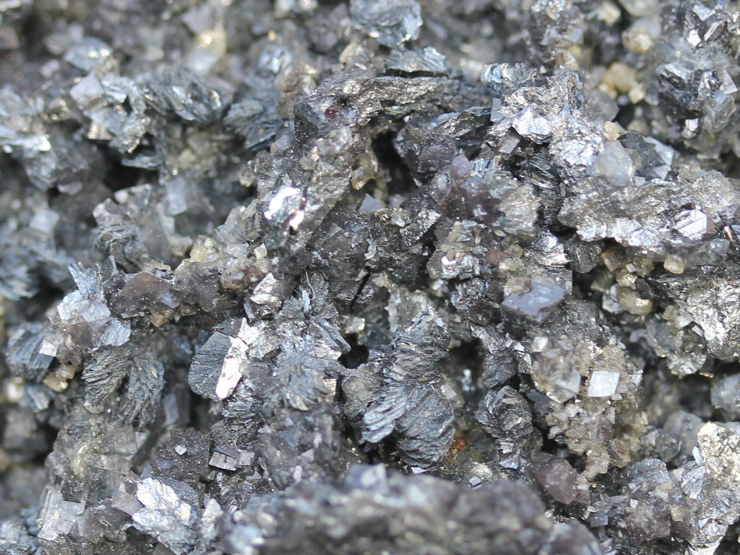 Semseyite and a combo of other sulfides.