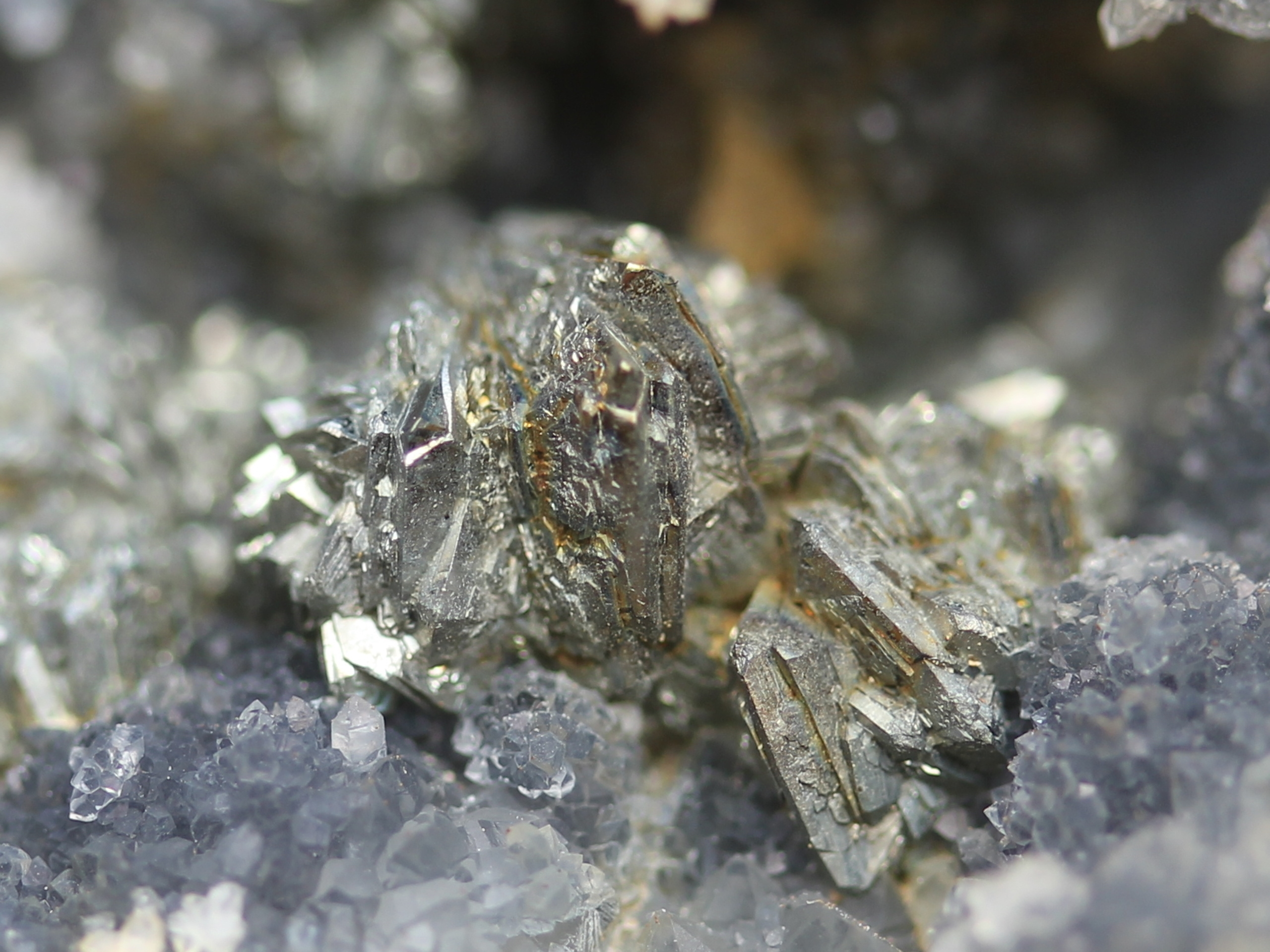 Small stibnite clusters (half spheres)