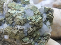 Chalcopyrite and small milky Quartz crystals