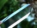 Polished crystal clear phantom quartz point